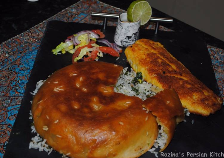 Persian herbed rice with fish (Sabzi polow mahi) for Iranian new year (Nowruz)