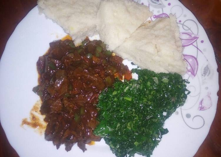 Liver served with ugali and greens