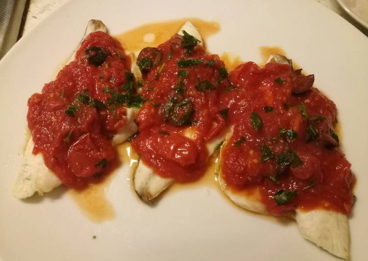 Sea bass with tomato and olive sauce