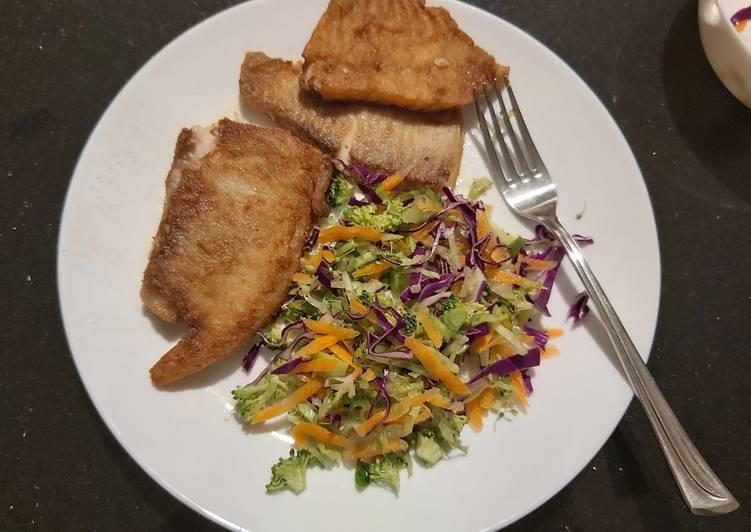 Fish fillet and salad