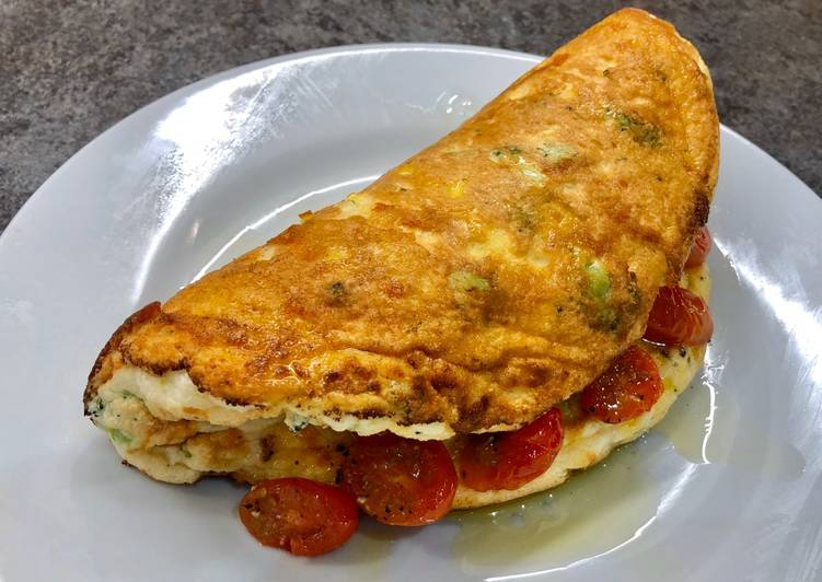 Cheddar, Broccoli and Red Chilli Soufflé Omelette, Garlic roasted Cherry Plum Tomatoes, Olive Oil