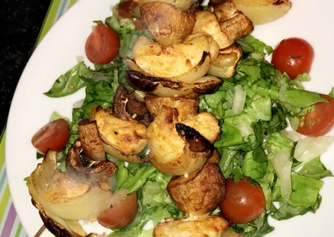 Healthy chicken skewers served with a salad