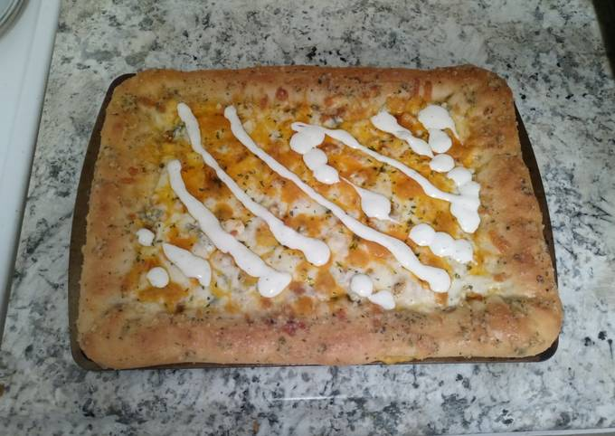 Homemade stuffed crust buffalo chicken pizza