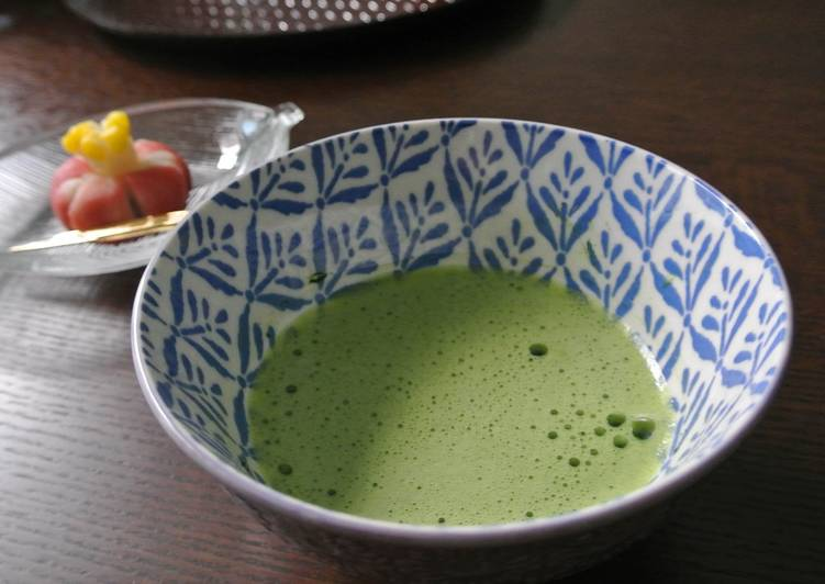 Preparing a cup of Matcha on a table