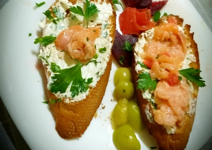 Grilled toast with feta cheese flavored with herbs and salmon