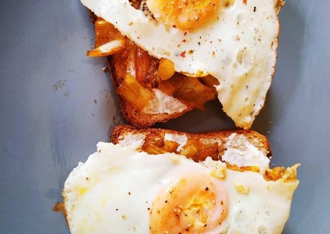 Eggs and leek on toast breakfast
