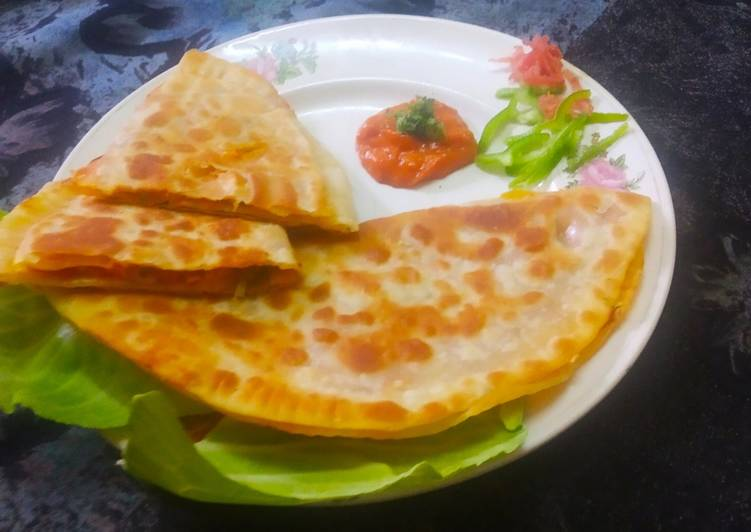 Indian style cheese paneer veg pizza paratha