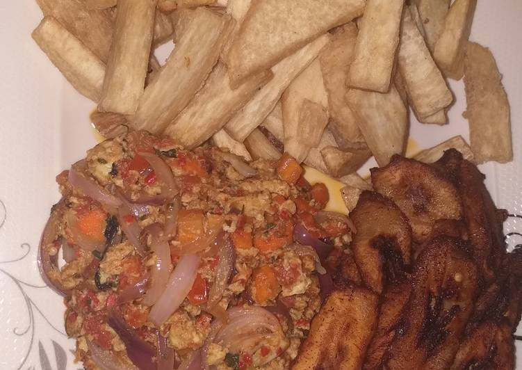 Fried yam with plantain and egg sauce