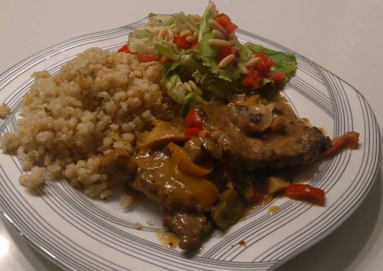 Beef picatta with brown rice and quinoa and a side salad