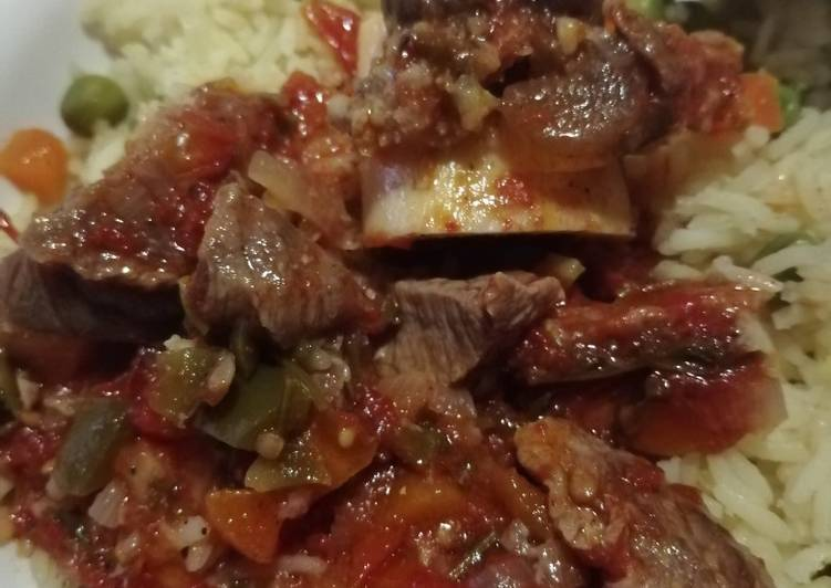 Cooked red meat with rice