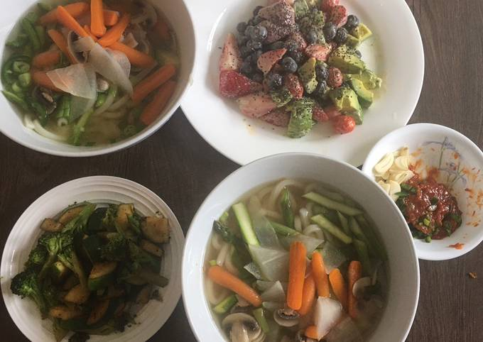 Udon noodle soup w/ side dishes of zucchini & fruit