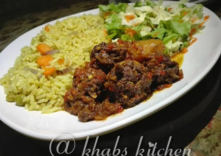 Fried rice with meat ball sauce and salad