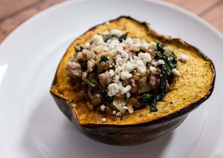 Roasted Acorn Squash with Sausage, Farro, Spinach, and Feta