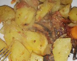 Chuleta de cerdo asada y verduritas