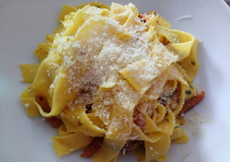 Papardelle with speck and chanterelle mushrooms