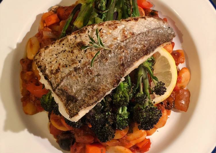 Seared hake. Butterbean, chorizo and olive stew. Purple sprouting broccoli