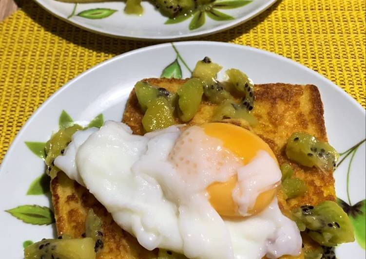 Breakfast toast with poached egg and kiwi