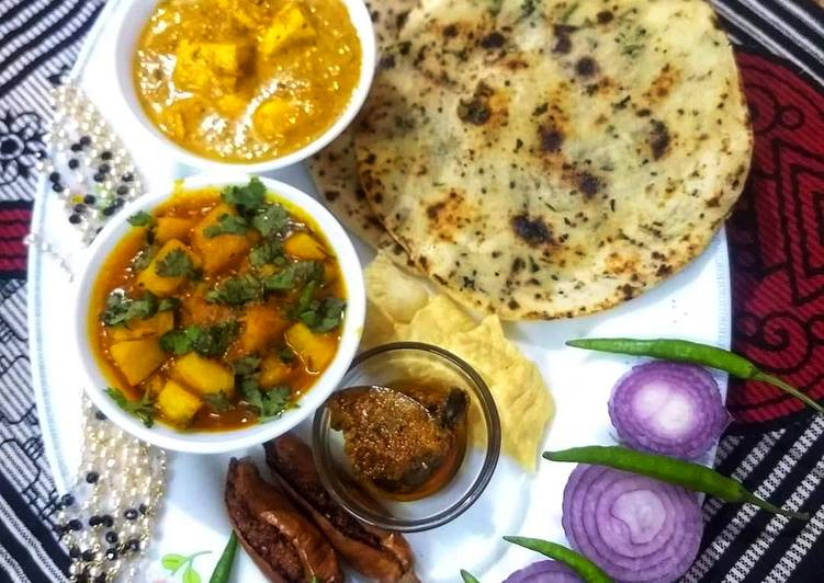 Butter paneer with naan and aloo gravy