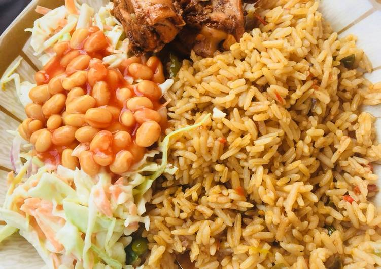 Jollof rice,salad and grilled chicken