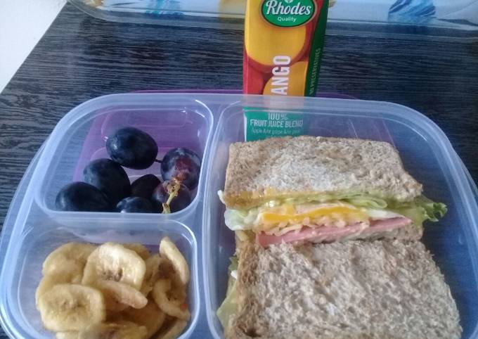 Egg sandwiches banana chips and grapes
