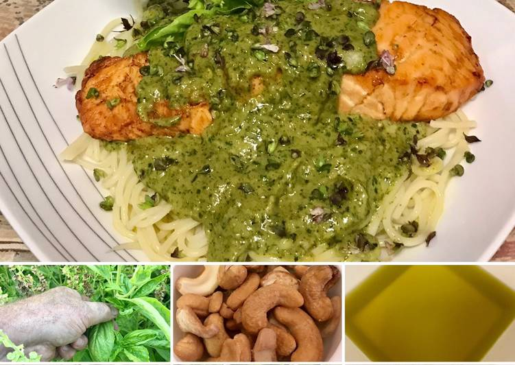 Grilled salmon with pesto on top of pasta