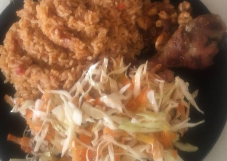 Recipe of Homemade Jollof Rice with salad,pan fried shrimps with fried chicken