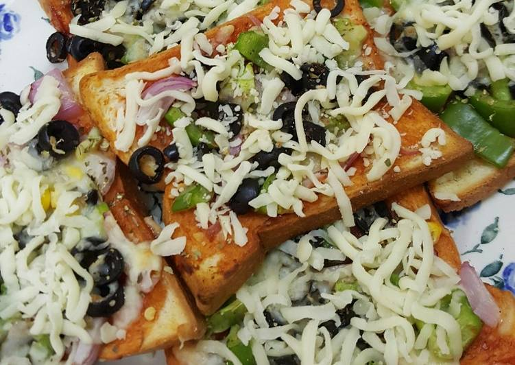 Bread pizza (dhara kitchen recipes)