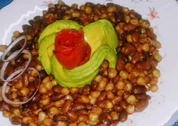 Chillie infused githeri with tomato rose and avocado rose