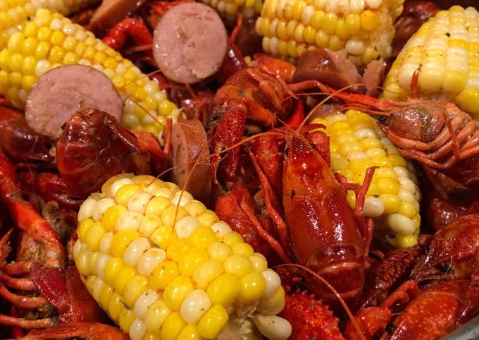 Cajun Inspired Spicy Buttered Crawfish Boil with Sausage and Corn