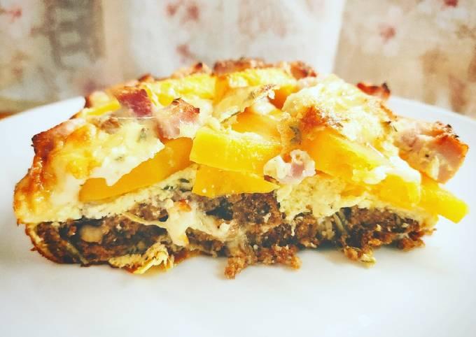Tortino di pane nero, zucca, formaggio e prosciutto cotto