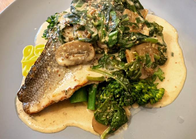 Recipe of Super Quick Homemade Pan fried Sea Bass with Wholegrain mustard, mushroom & spinach sauce. Finished with wild garlic