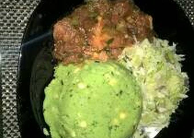 Mukimo served with wet fry beef and steamed cabbage