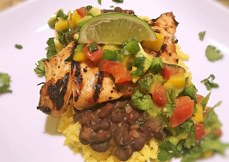 Island chicken with beer braised black beans and yellow rice