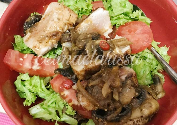 Pan Grilled Marlin With Mushroom Sauce on Top of Red Rice