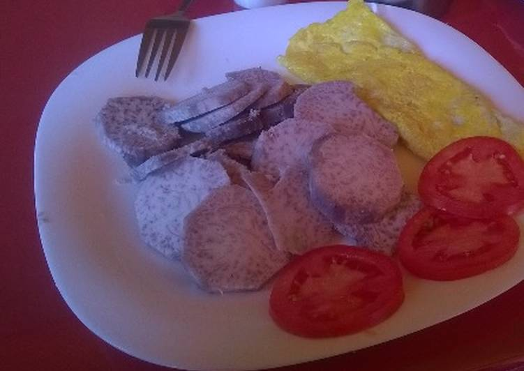 Arrowroots served with fried egg and tomatoes - Laurie G Edwards