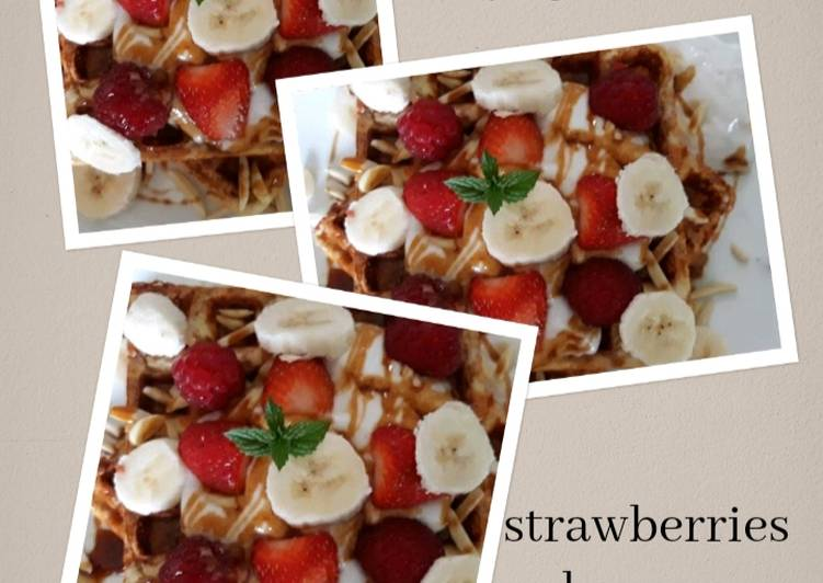 Waffles with vanilla coconut yoghurt & strawberries banana maple