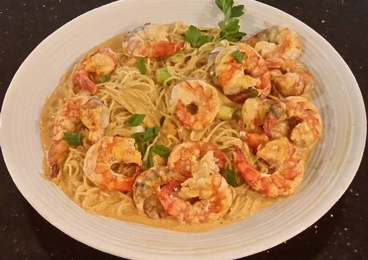 Poached Shrimp with Siriacha Cream Sauce on Angel Hair Pasta