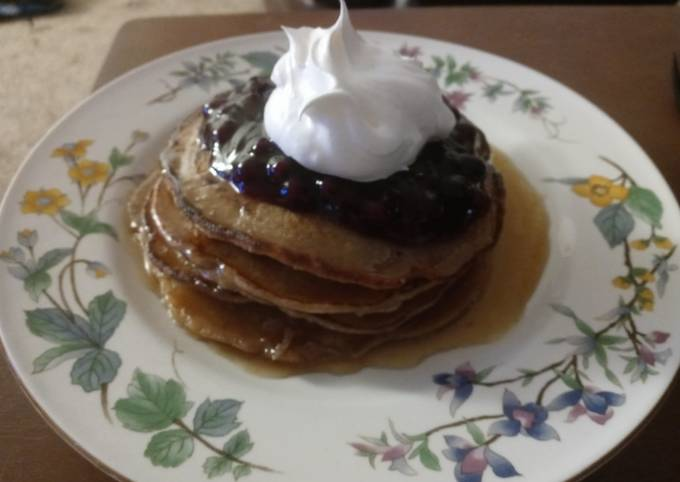 Cinnamon Clove Pancakes with Blueberry Sauce and Whipped Cream