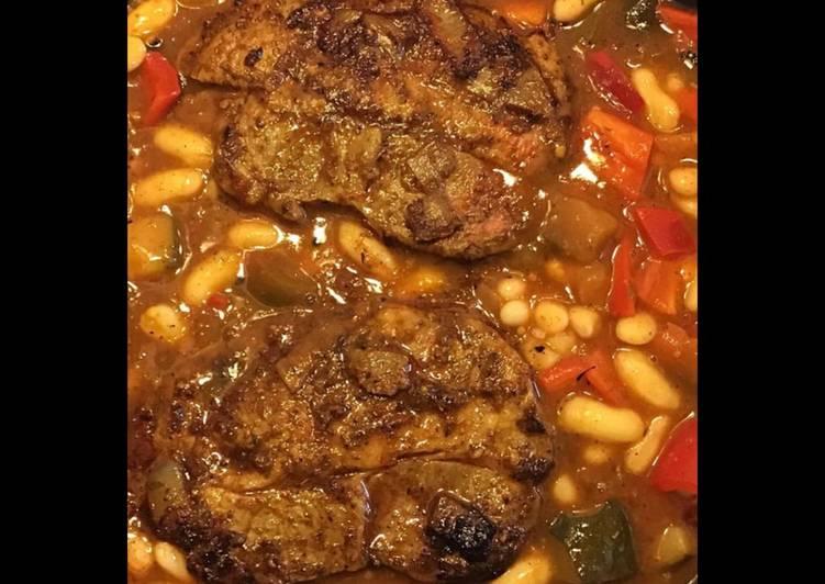 Recette De Côtes de porc aux courgettes poivrons tomates et haricots blancs