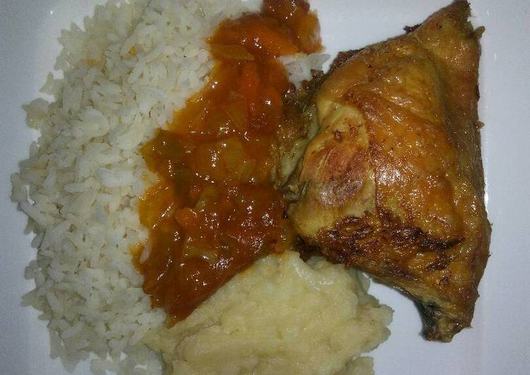 Tasty grilled chicken with rice and mashed potatoes