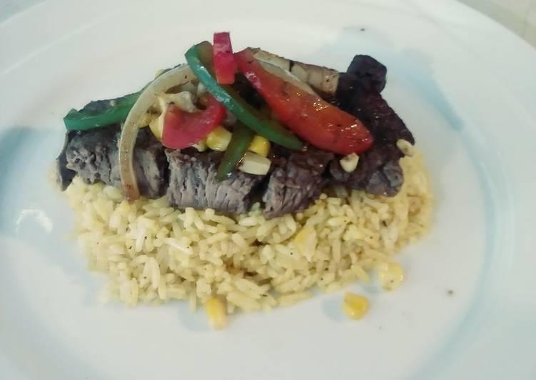 Steak & Turmeric Rice with Sauteed Corn, Onions & Pepprs