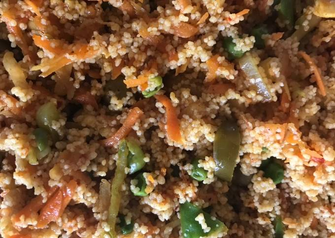 Cous cous cooked salad with tikka chicken