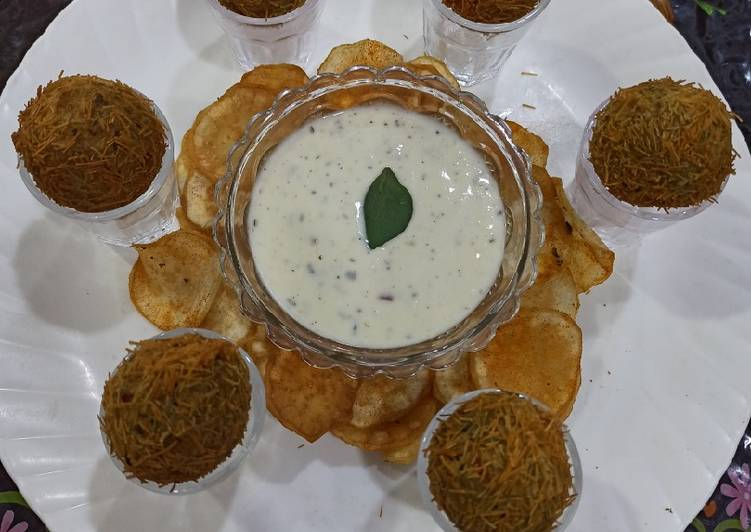 Chessy cracker and chips with sauce - Laurie G Edwards