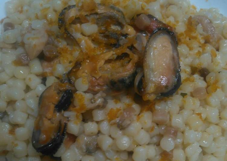 Recipe: Delicious Sardinian fregola with mussels, clams, salmon and bottarga