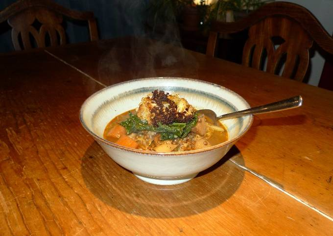 Puy lentil stew with baked cauliflower and steamed cavolo nero