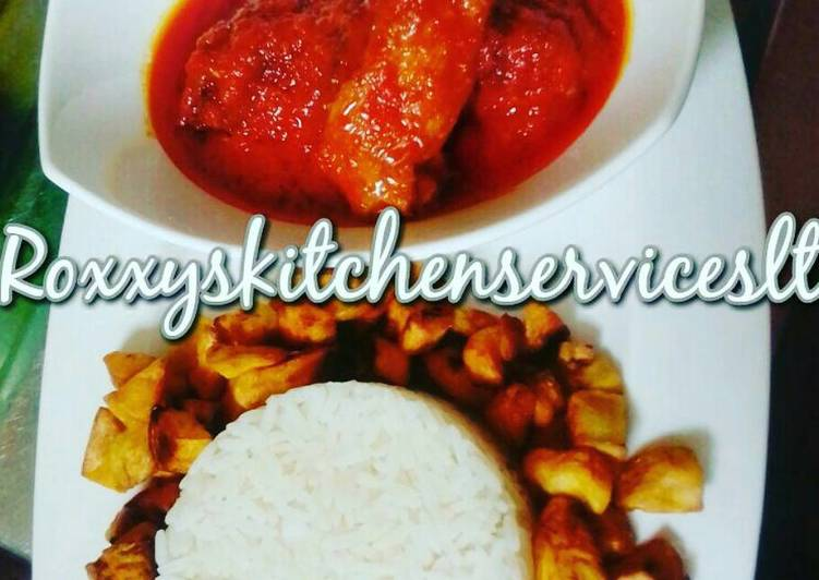 Palm oil chicken stew served with white rice and fried plantain