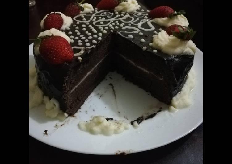 Chocolate cake with chocolate ganache and whipped cream icing
