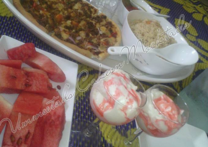 Chinese rice, pizza, watermelon and whipped cream