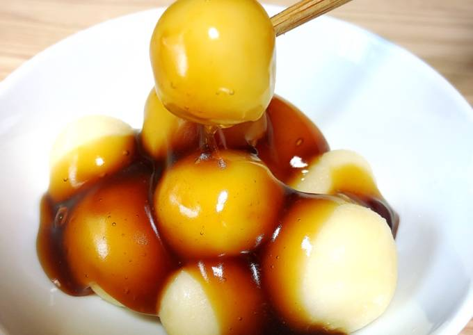 Japanese dessert Mochi with sweet soy starchy sauce