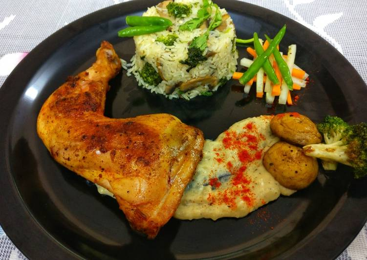 Pan seared chicken, served with herb rice & mashed potatoes
